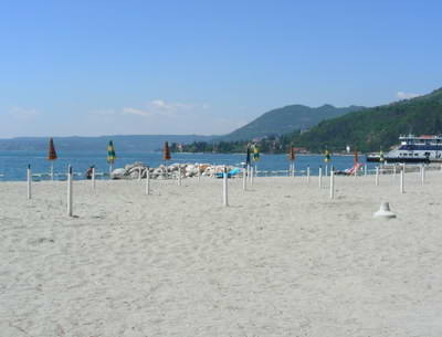 The large beach at Maderno complete with stands for sun shades