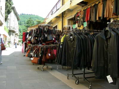 A typical Garda shop with leather goods out  the front on display.