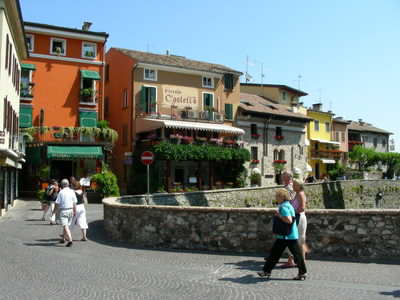 A typical narrow and colourful street in Sirmione