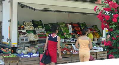 A large roadside fruit and veg stall