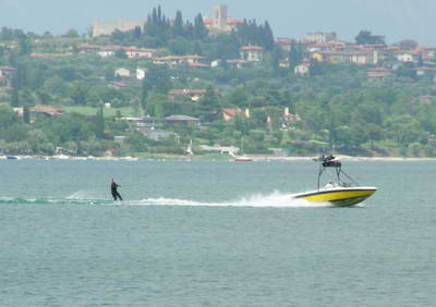 Waterskier with Moniga castle in the background.